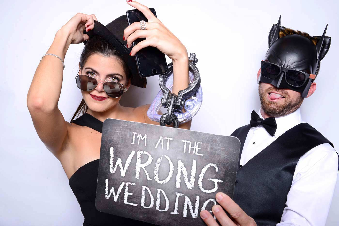 """Belleair Photo Booth with a sign that reads """"I am at the wrong wedding"""""""