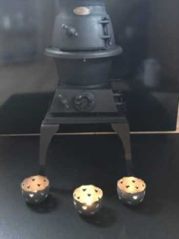 stove and 3 tealights e1511799978730 225x300 - Pot Bellied Stove - a necessary addition to The Shepherds Hut