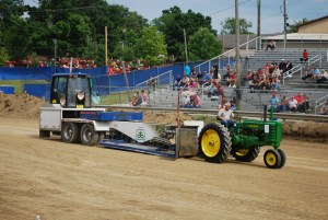A man pulling a weight sled with his antique John Deere tractor at the 2016 Whitley County 4-H Fair Tractor pull