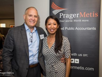 Phil & Mia Whitman at Prager Metis Cranbury, NJ Office open house.