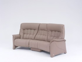 himolla Rhine Sofa in light brown leather, shown in plain studio setting.
