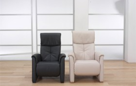 himolla Humber Recliner, shown in pale cream or black options, in living room setting.