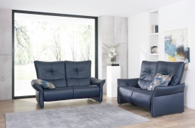 himolla Brent Sofa shown in dark blue leather, in a living room setting.