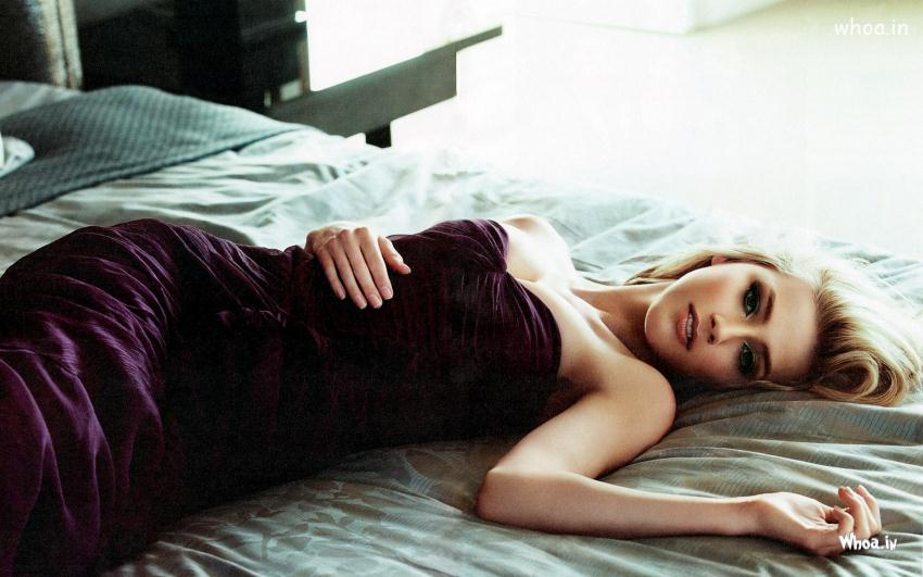 Amber Heard In Purple Dress And Laying On A Bed