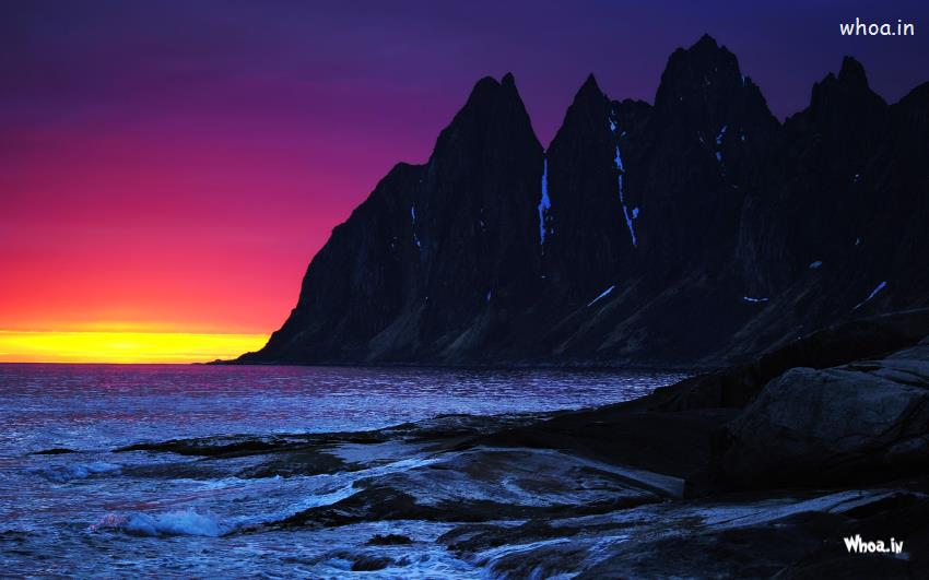 Amazing Natural Sunset Eith Sea And Black Mountain