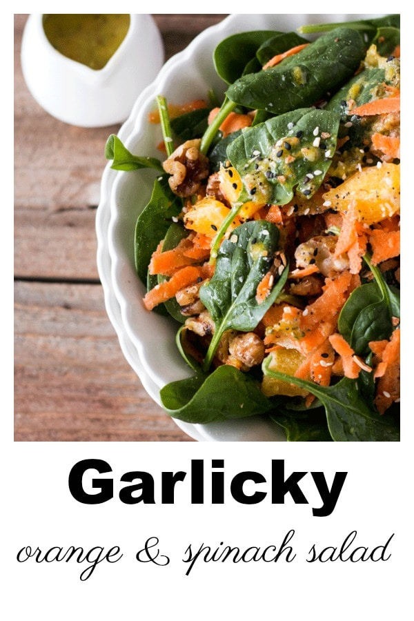 So simple, and yet so flavorful, this Garlicky Orange Spinach Salad is a fantastic way to showcase all that the season has to offer. Sweet orange zest, fruit and flesh are combined with some earthy spinach and crunchy walnuts, with a punch of fresh garlic to give a flavor combination that wows. #vegan #vegetarian #winter #wintersalad #oranges
