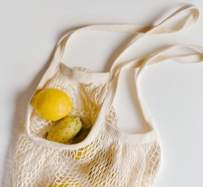 lemons coming home from the market in a hessian bag: reduce food waste