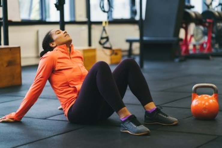 Exhausted female athlete in the gym