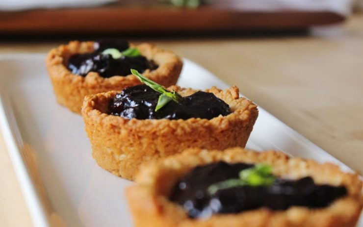 Lemon and macaroon cups with blueberry and basil compote
