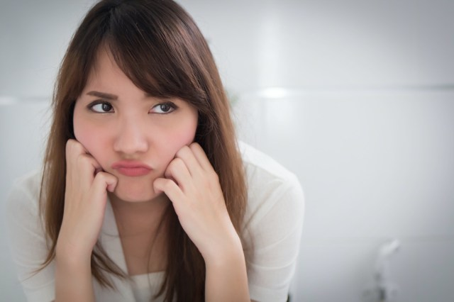 angry woman in toilet due to diarrhea, constipation, hemorrhoids, piles