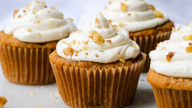 Carrot cupcakes with cream cheese frosting and chopped walnuts