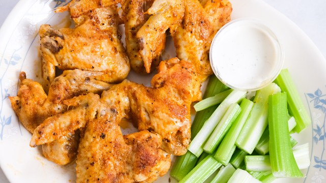 ready-made chicken wings with blue cheese dip and celery on a plate