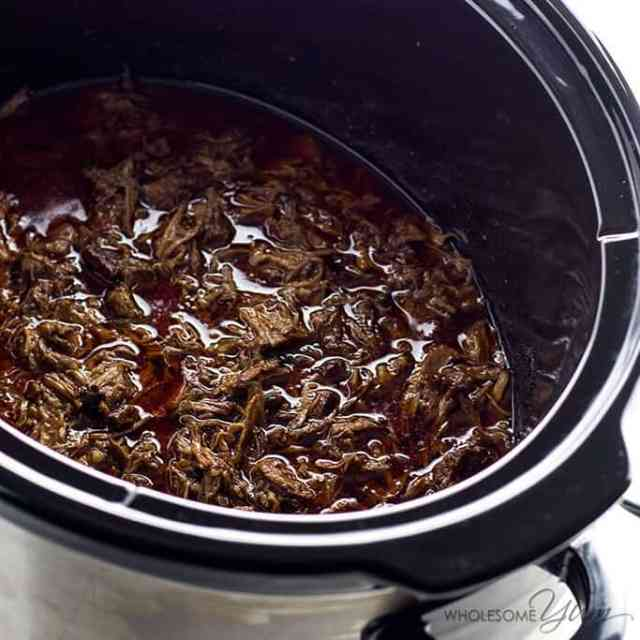 Chipotle Beef Barbacoa Recipe Copycat in a Slow Cooker (Crock Pot) - If you love barbacoa beef, you have to try this copycat Chipotle barbacoa recipe in a slow cooker. It's healthy, easy, naturally low carb, paleo, gluten-free and fall-apart delicious. The best Crock Pot barbacoa ever!
