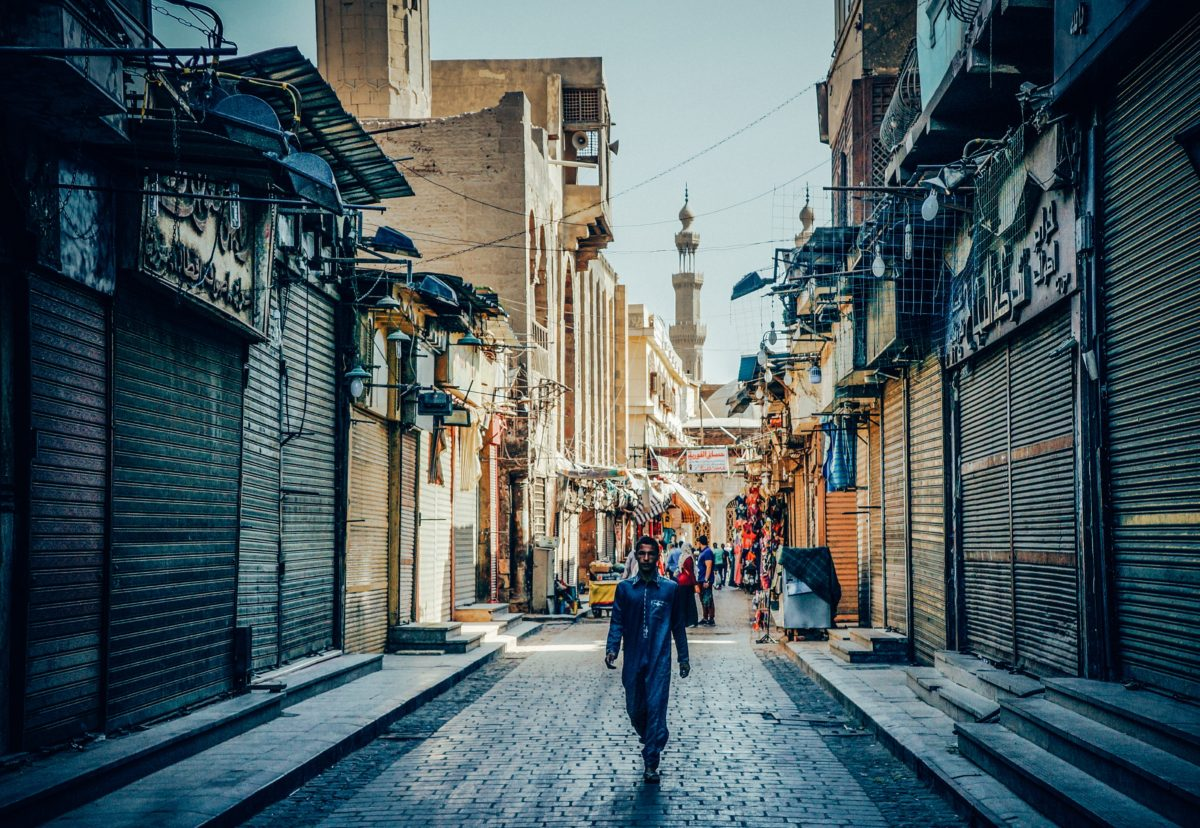A guy walking the streets of Islamic Cairo by Alejandro Garcia via Unsplash