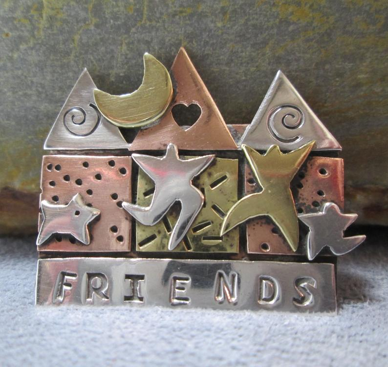 Mixed metals friends pin