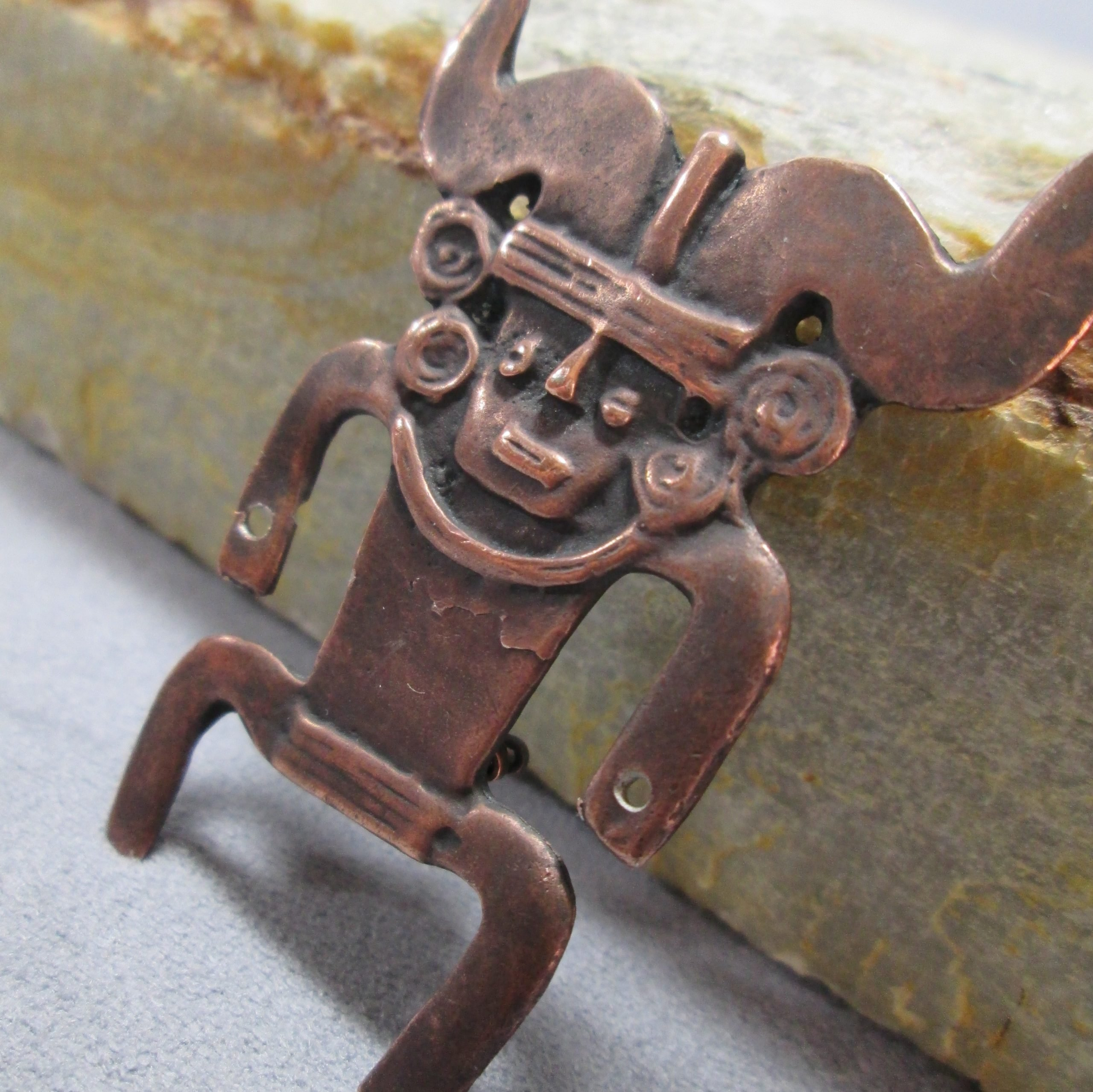 copper tribal figure brooch