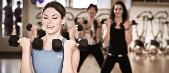 Ladies working out using free weights for toning