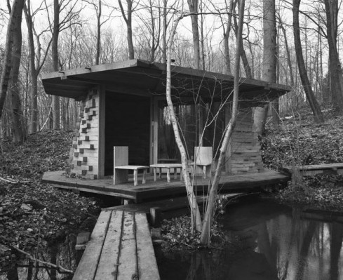 Cabin made of stacked wood in the woods