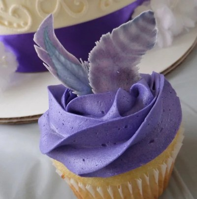 Wickstead's-Customer-Photo-of-our-Edible-Purple-Passion-Feathers-on-Purple-Cupcakes