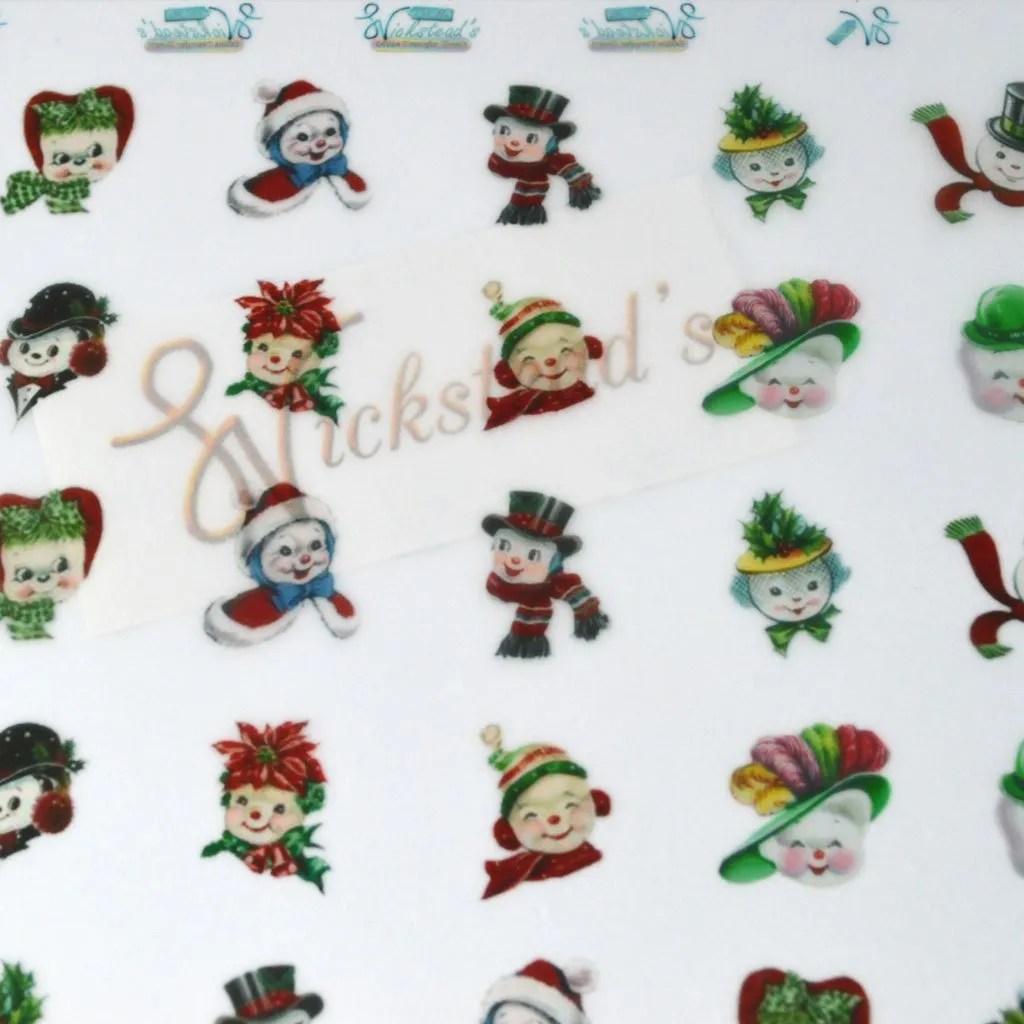 Wickstead's-Eat-Me-Edible-Chocolate-&-Meringue-Transfer-Sheets–Snowmen-&-Snowwoman-Faces-(1)