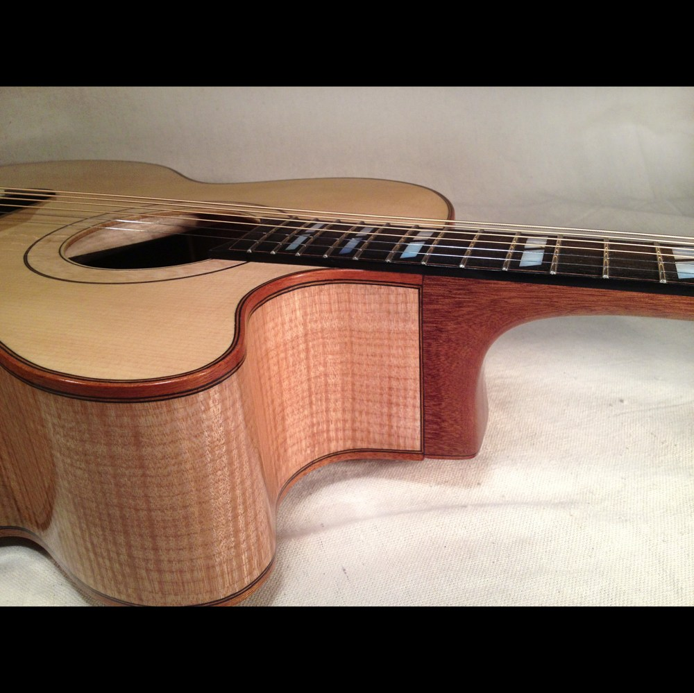 P185, a replica of the Gibson J185 with a Venetian cutaway.