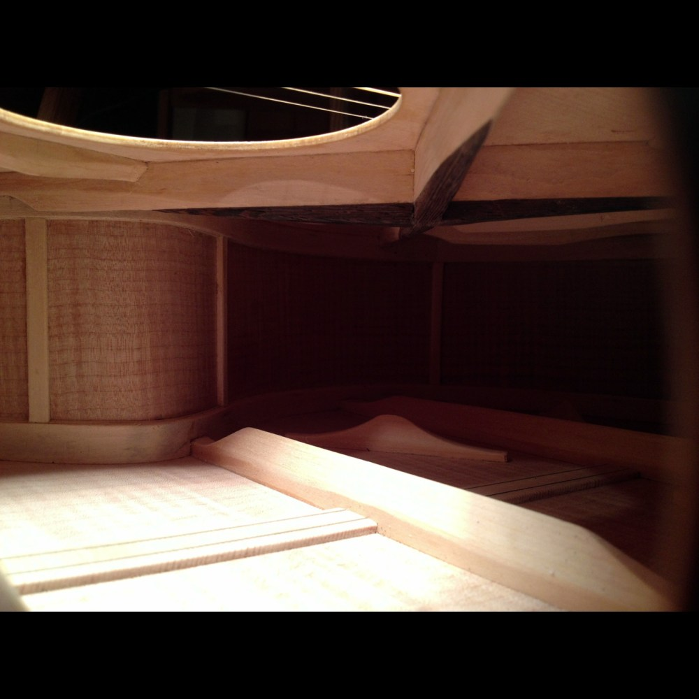 The bracing inside the P185, a replica of the Gibson J185 with a Venetian cutaway.