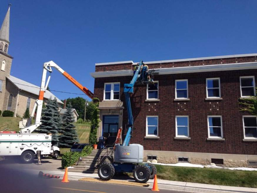 Painting the trim around the building