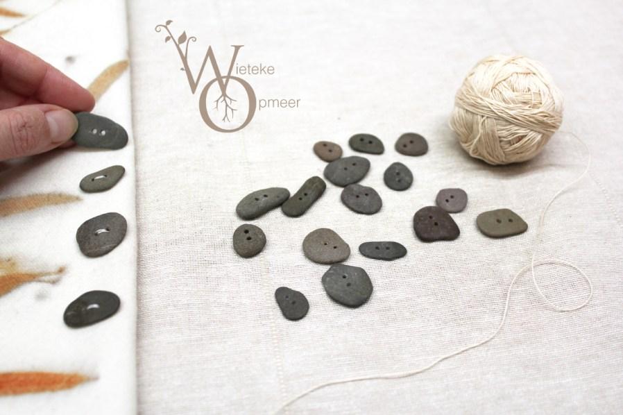 handmade riverstone buttons on fabric