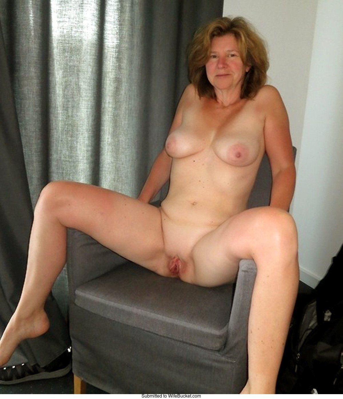 Older Wife Fully Naked On The Chair