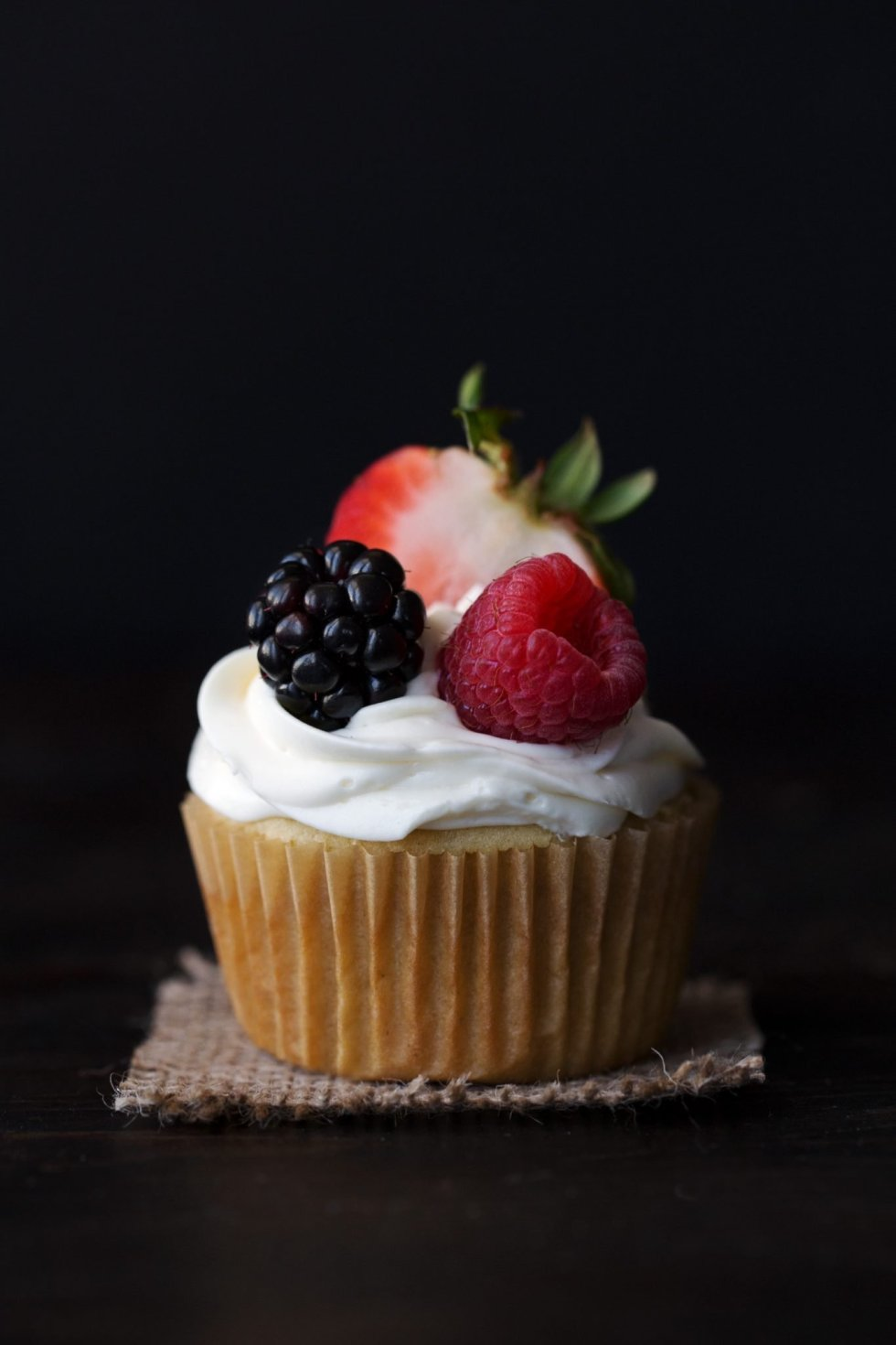 Berry Filled Vanilla Cupcakes with Lemon Cream Frosting