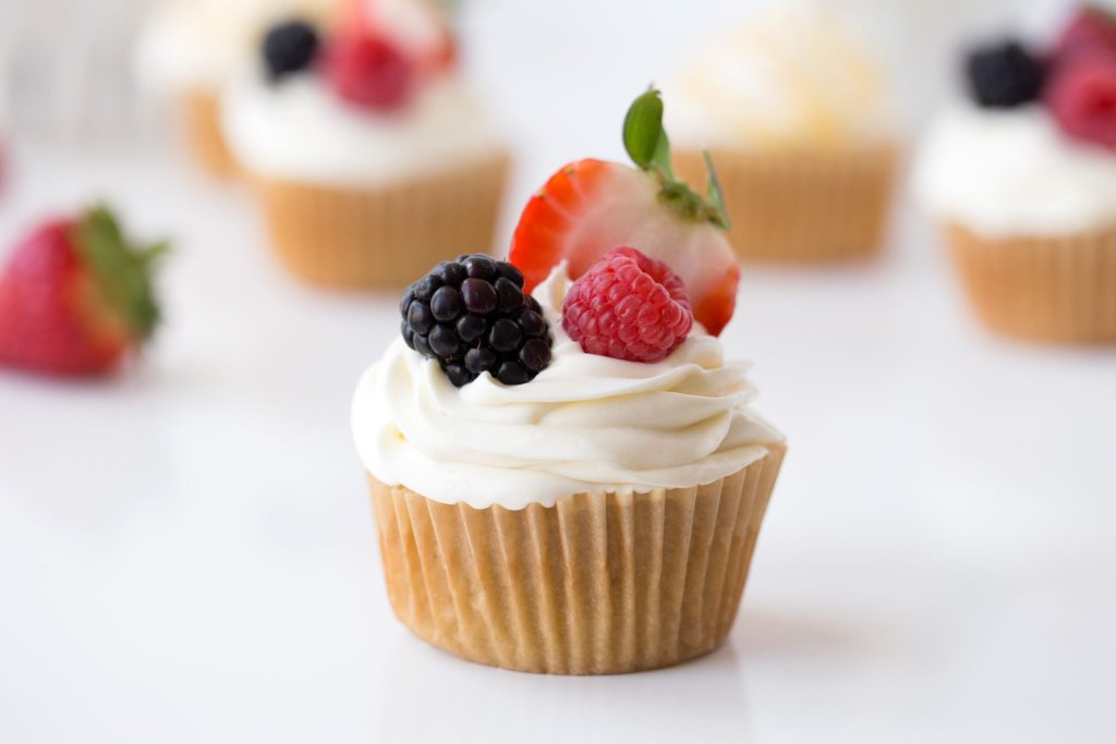 Berry Filled Vanilla Cupcakes with Lemon Cream Frosting | Free of gluten and refined sugar. Can also be adapted to be dairy free.