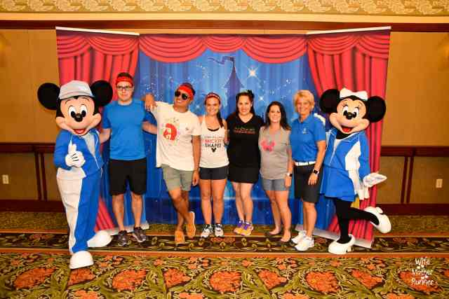 Team Mickey getting photos with Mickey and Minnie Mouse