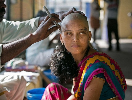 Woman shaving hair wigs