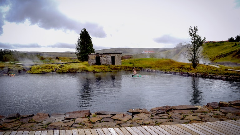 The Secret Lagoon geothermal hot spring in Iceland