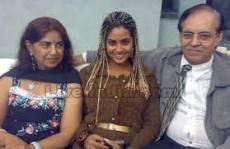 Meera Chopra with her parents