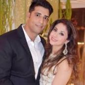 Mohsin Akhtar Mir with his wife