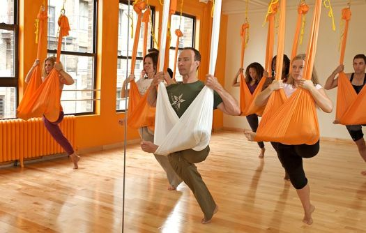 Aerial yoga exercise in air conditioned room