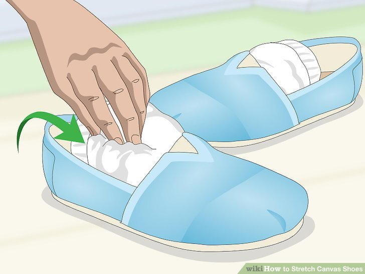 Stuff a ball of socks in your shoes to widen them.