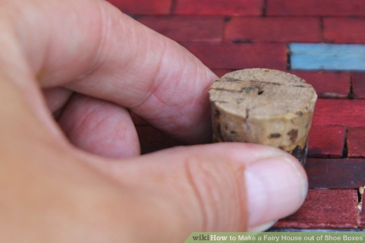 Use thread spools or wine corks to make tables and chairs.