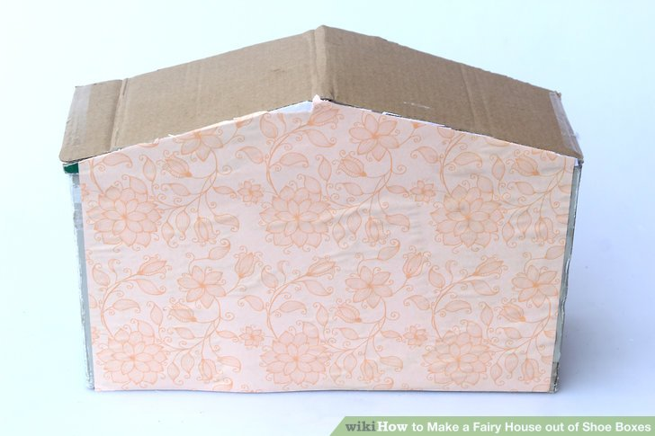 Cover the outside of the house with paper, if desired.