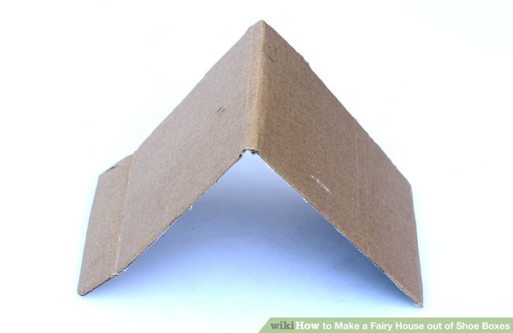 Fold the strip in half widthwise to make a V-shape.