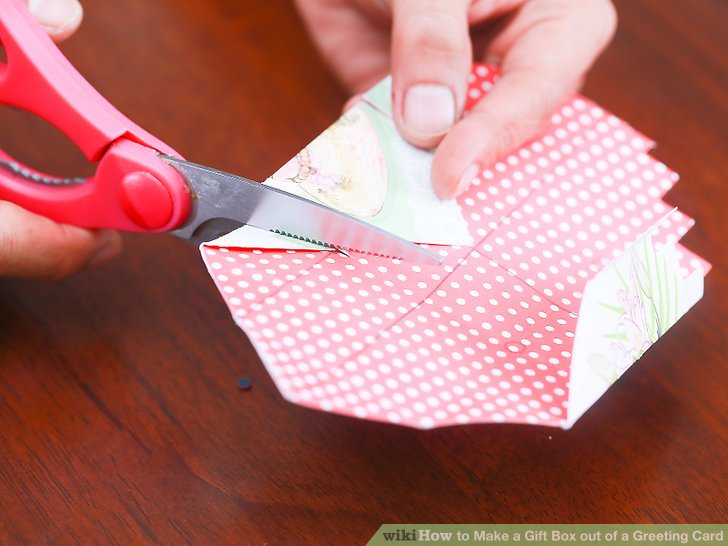 Make 4 careful cuts along the crease line, from the edges, up to the next crease mark.