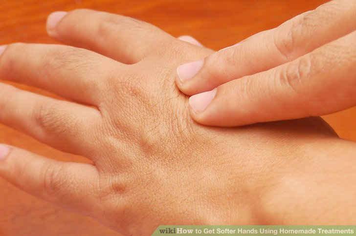 Rub the palms together and then use the thumb of the opposite hand to massage the palm in a circular motion while keeping your fingers interlaced.