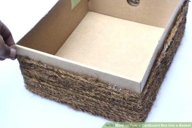 Kleben und wickeln Sie die Kordel weiter um die Schachtel, bis Sie die Oberseite der Schachtel erreichen.