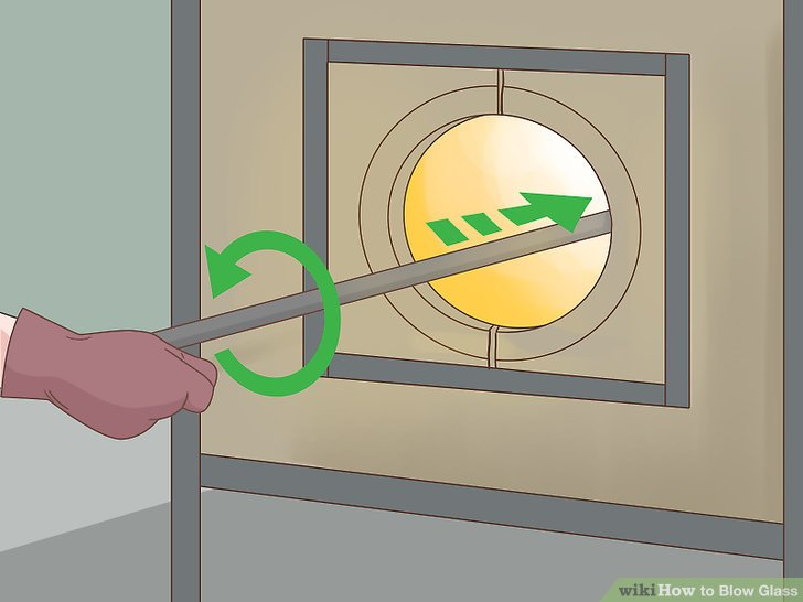 Put the glass in the crucible, or glory hole, and turn it several times.