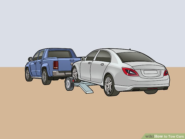 Fahren oder schieben Sie das kaputte Fahrzeug auf den Abschleppwagen.