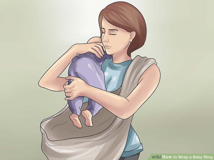 Legen Sie die Füße Ihres Babys in die Schlinge.