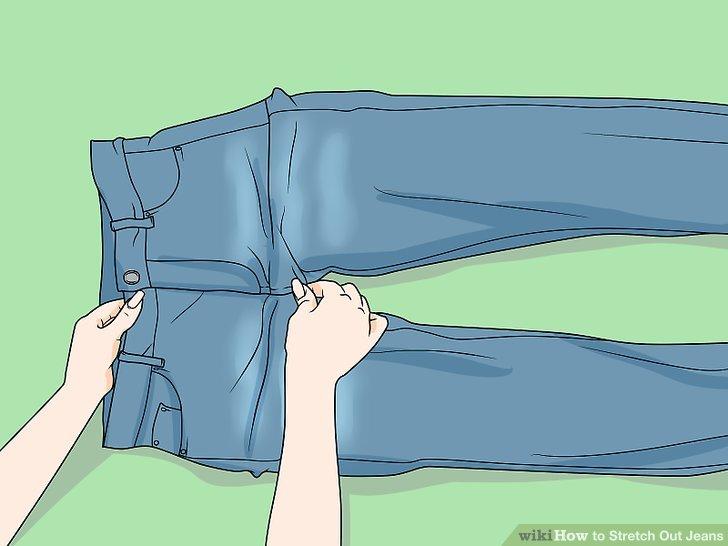 Heizen Sie die Jeans mit einem Fön auf mittlerer Stufe.