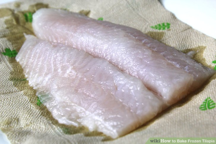 Rinse and dry the frozen tilapia.