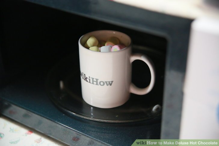 Put your hot chocolate in the microwave for 60 seconds and then take it out.